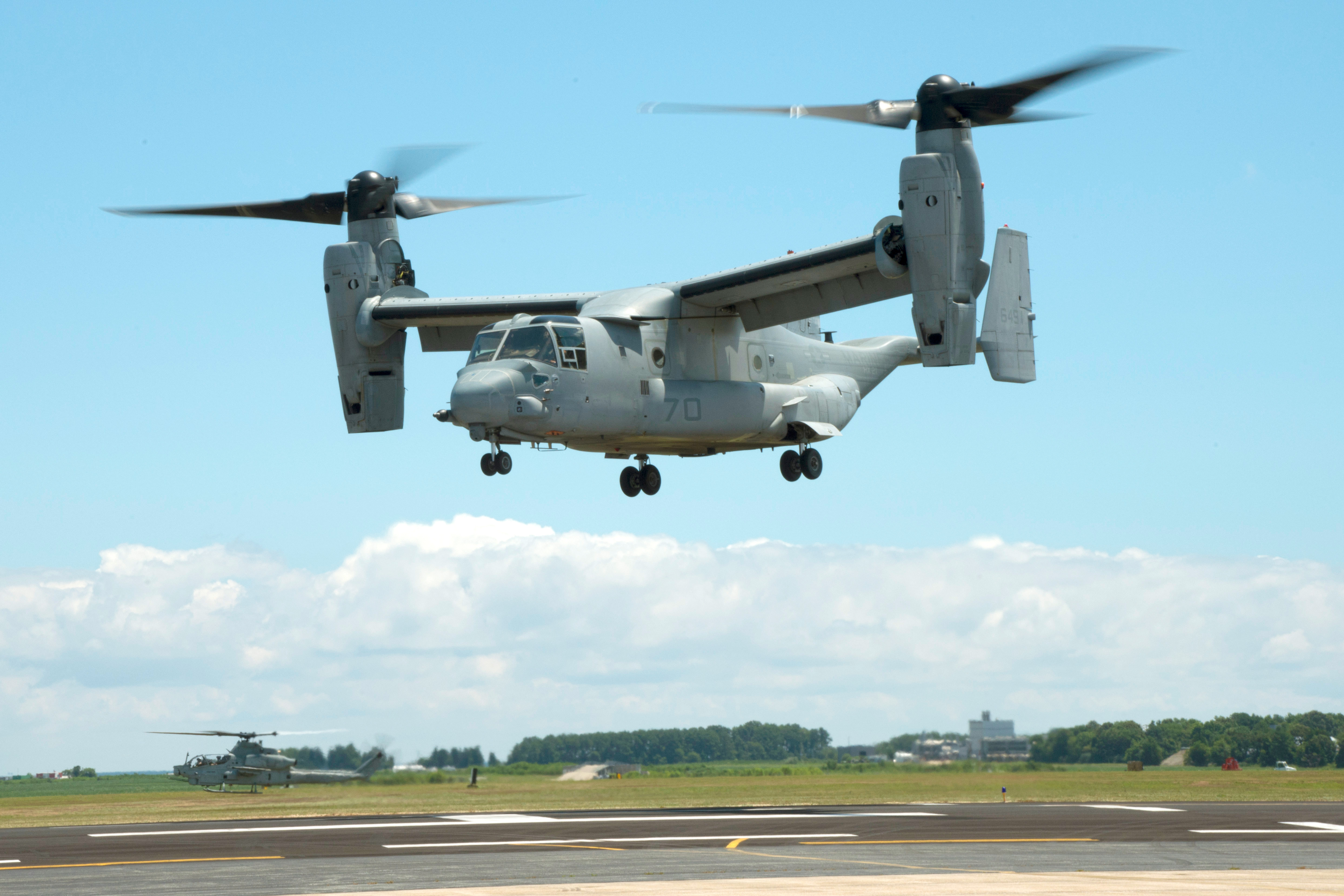 160729-N-JM744-117 PATUXENT RIVER NAVAL AIR STATION, Md. (July 29, 2016) An MV-22B Osprey equipped with a 3-D printed titanium link and fitting inside an engine nacelle maintains a hover during a July 29 demonstration at Patuxent River Naval Air Station, Md. The flight marked Naval Air System Command's first successful flight demonstration of a flight critical aircraft component built using additive manufacturing techniques. (U.S. Navy photo/Released)